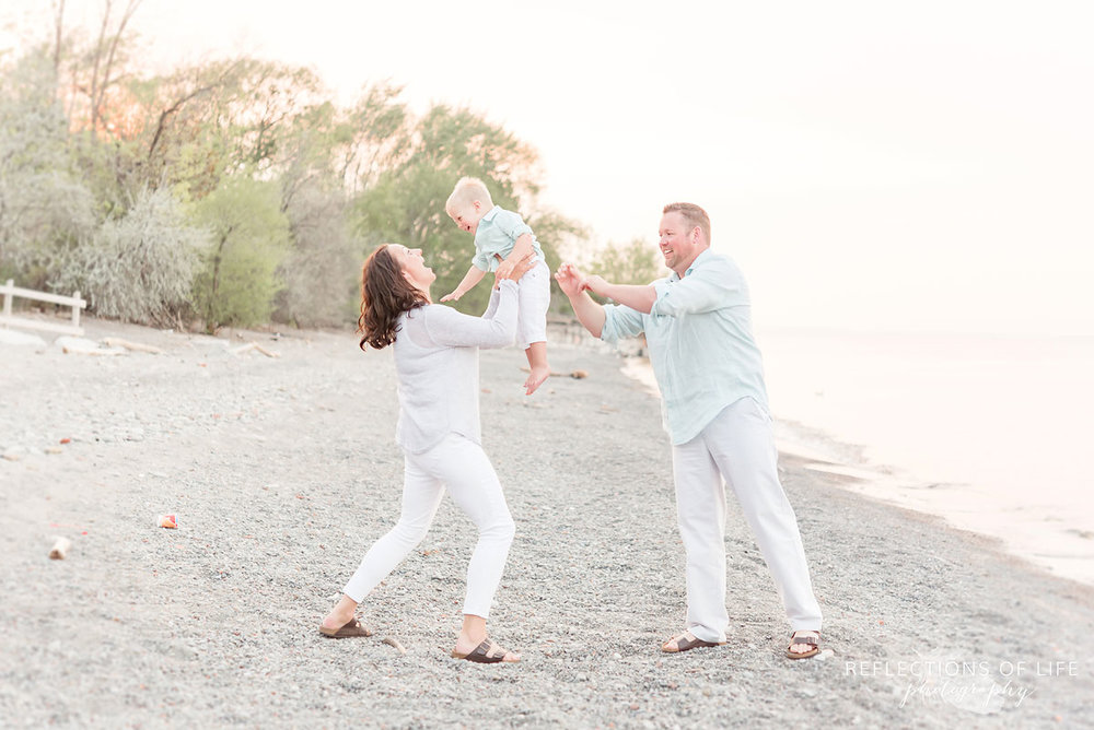 Candid family photography by Lake Ontario