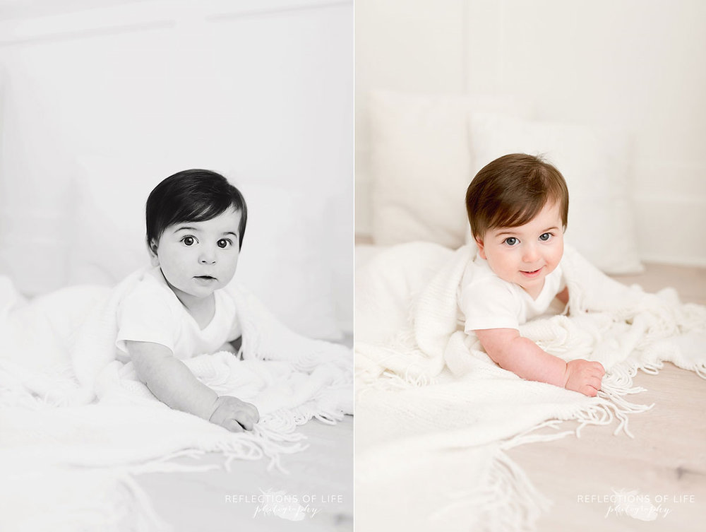 Baby on white blanket in white studio