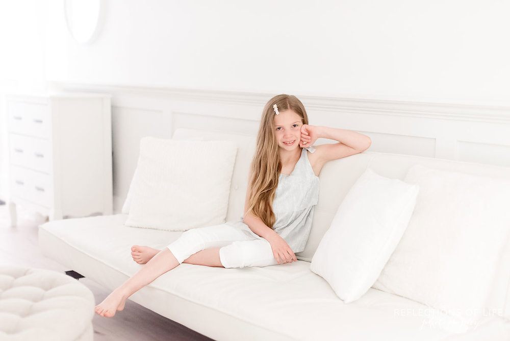 white studio girl sitting on couch