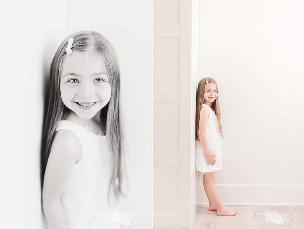 young girl leaning up against wall in studio