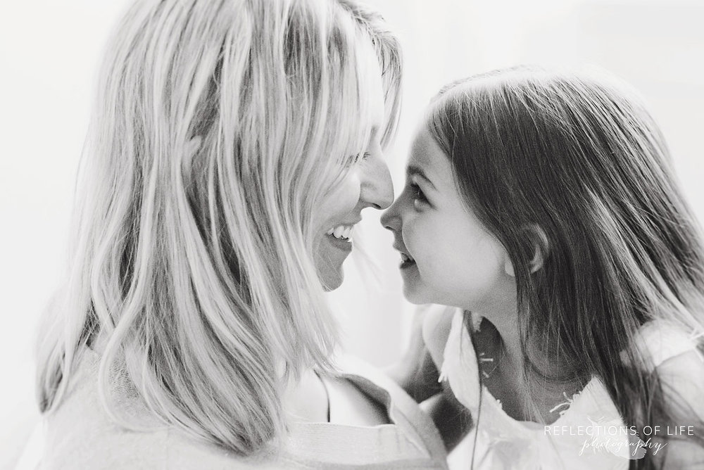 mother and daughter looking at each other smiling