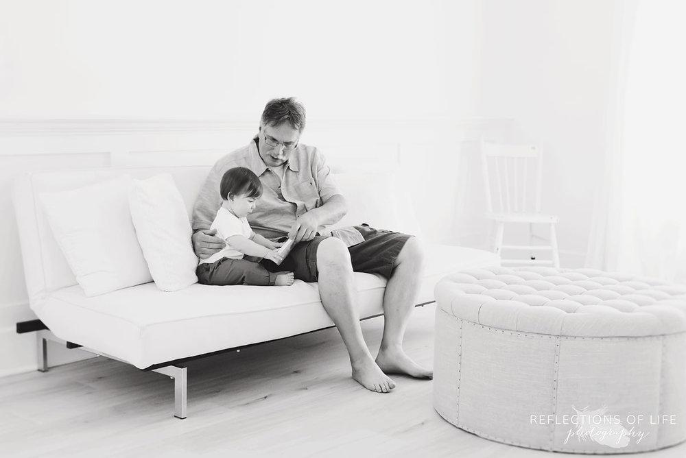niagara photographer black and white grandpa reading to grandson