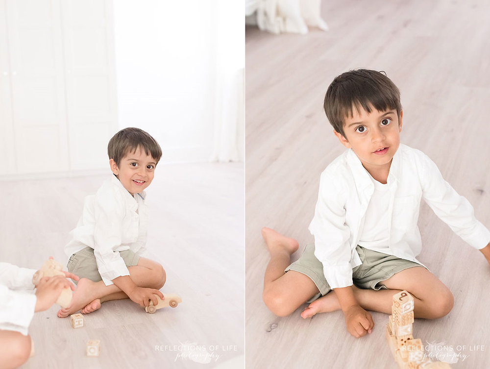 young boy sitting on floor with blocks