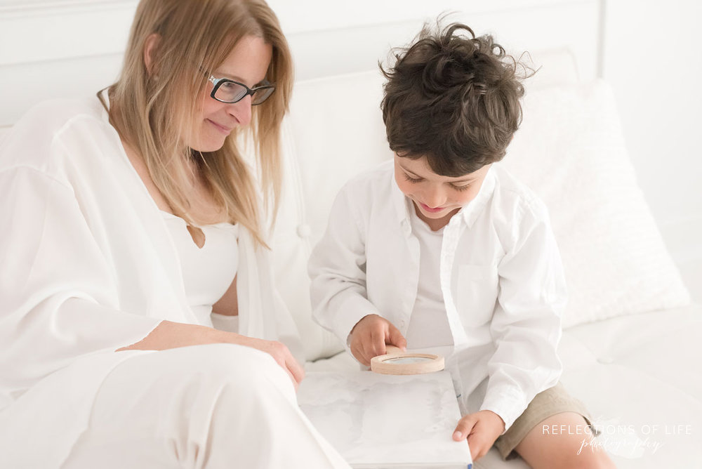 mother and son sitting together on white couch