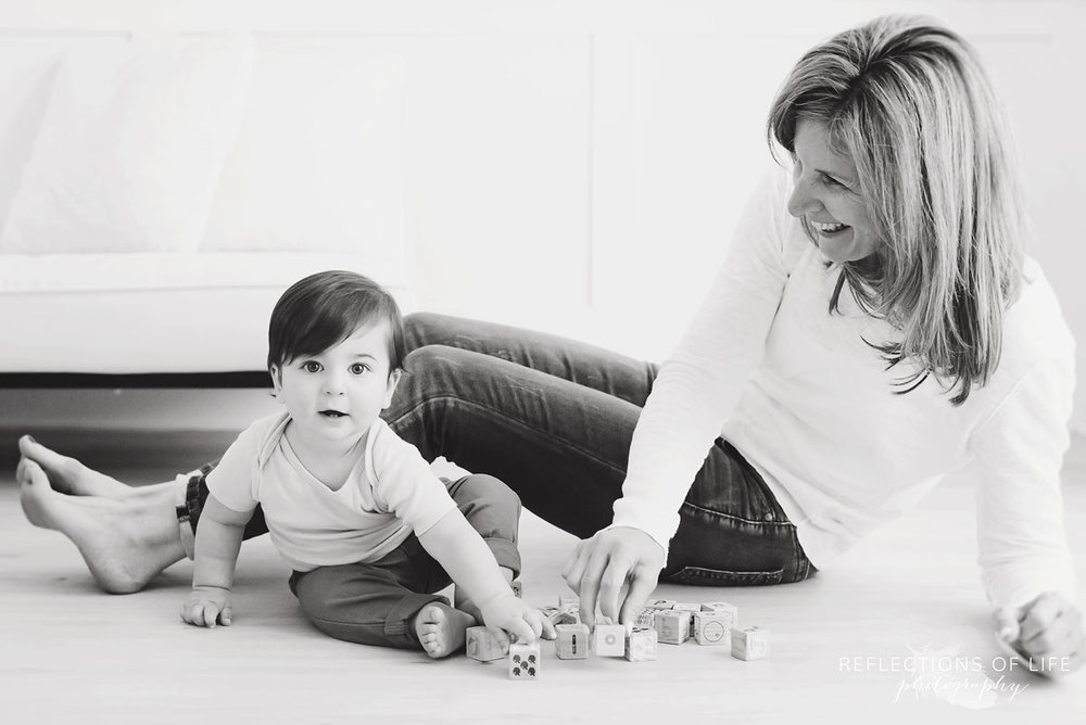Black and white photo of Grandma playing with her grandson