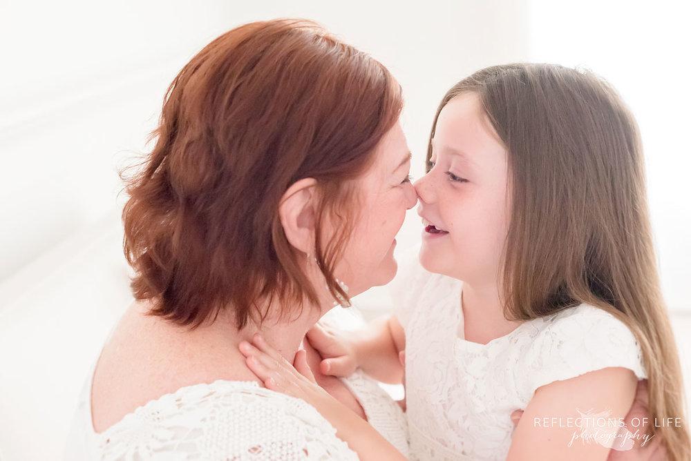 Portrait of Grandma and grandchild rubbing noses