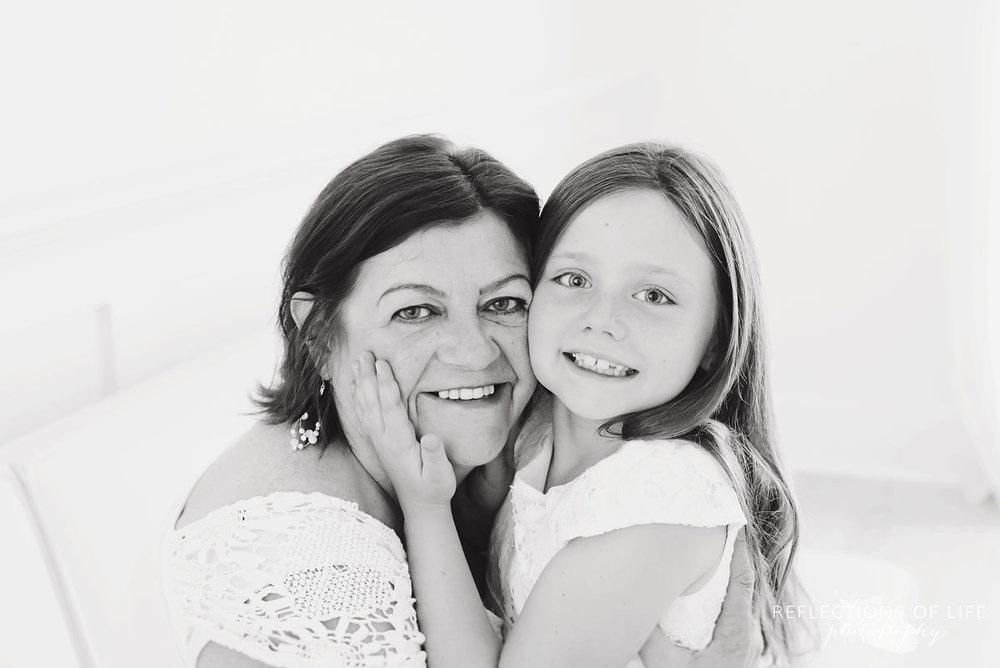 Portrait of Grandma and grandchild smiling at the camera