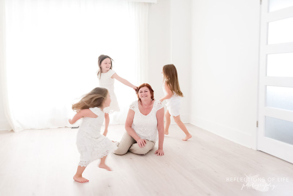 Dancing around Grandma while listening to music in a natural light studio