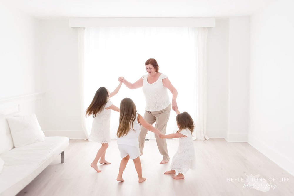 Natural light photography of dance party by the window.jpg