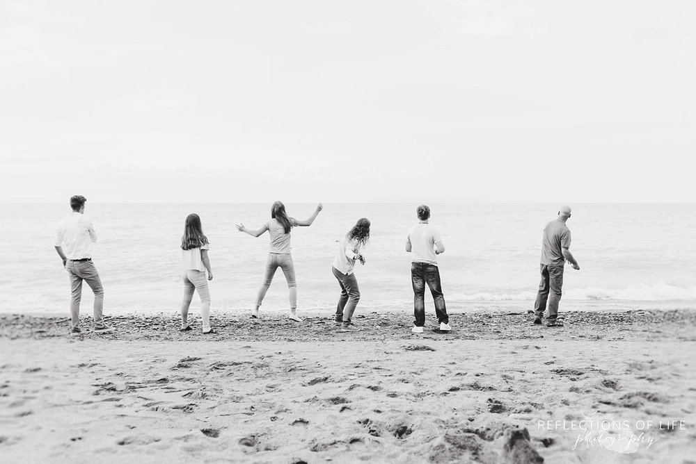 Fun and candid Family photos by the beach in Grimsby Ontario