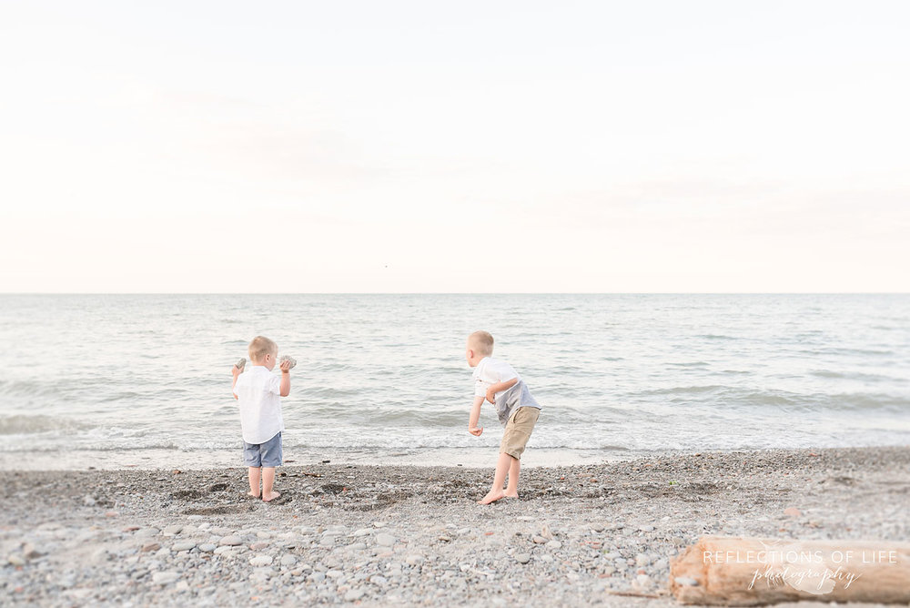 Two boys playing at the beach in Grimsby Ontario