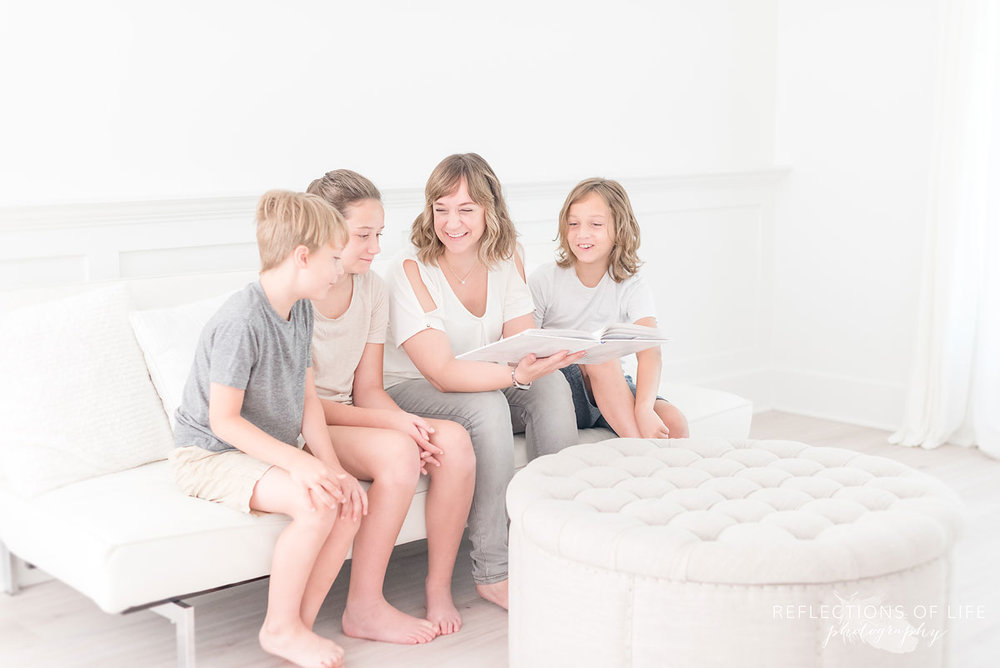 Mom reading a story to her kids in Grimsby Ontario Canada.jpg