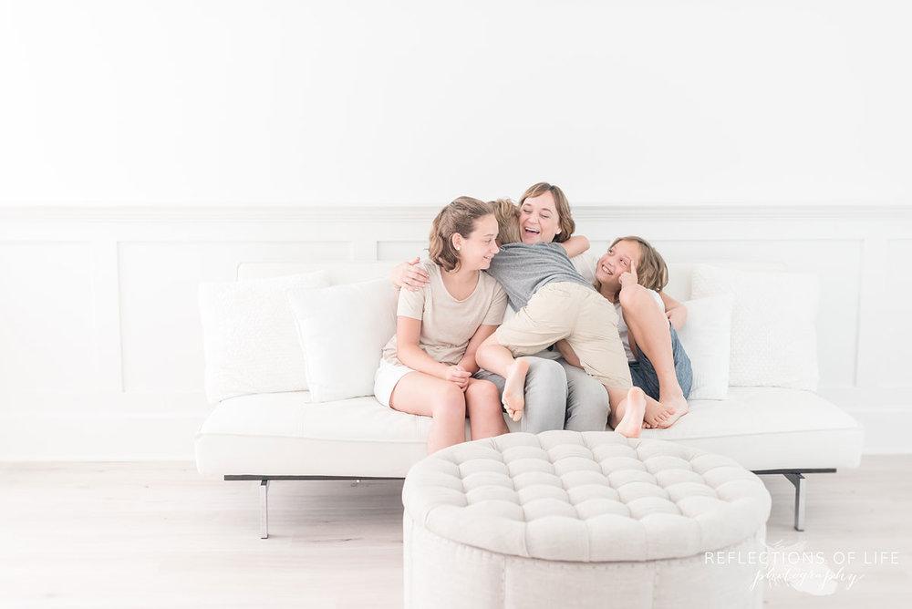Big hugs between Karen Byker pro photographer and her youngest three kids.jpg
