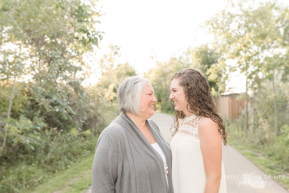 Mom and daughter laughing in Grimsby Ontario