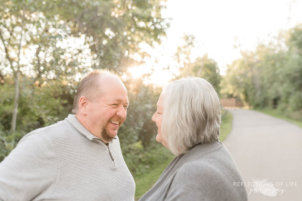 Mother and Father laughing with each other in Niagara Region