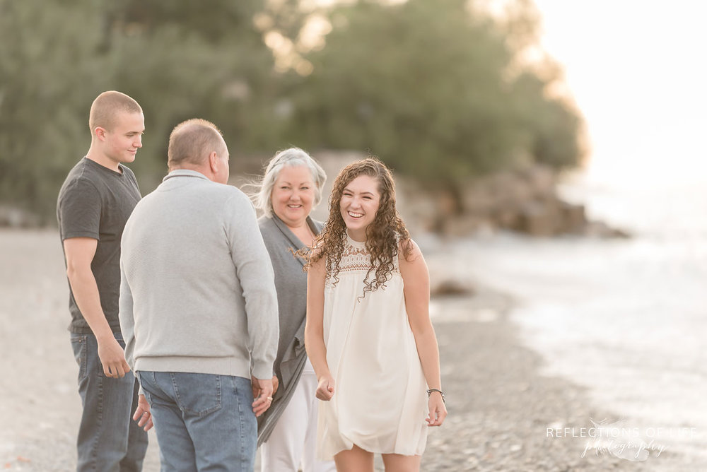 Family talking and laughing together in Niagara Region