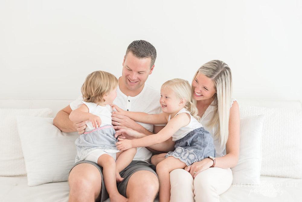 Family of four in white studio.jpg