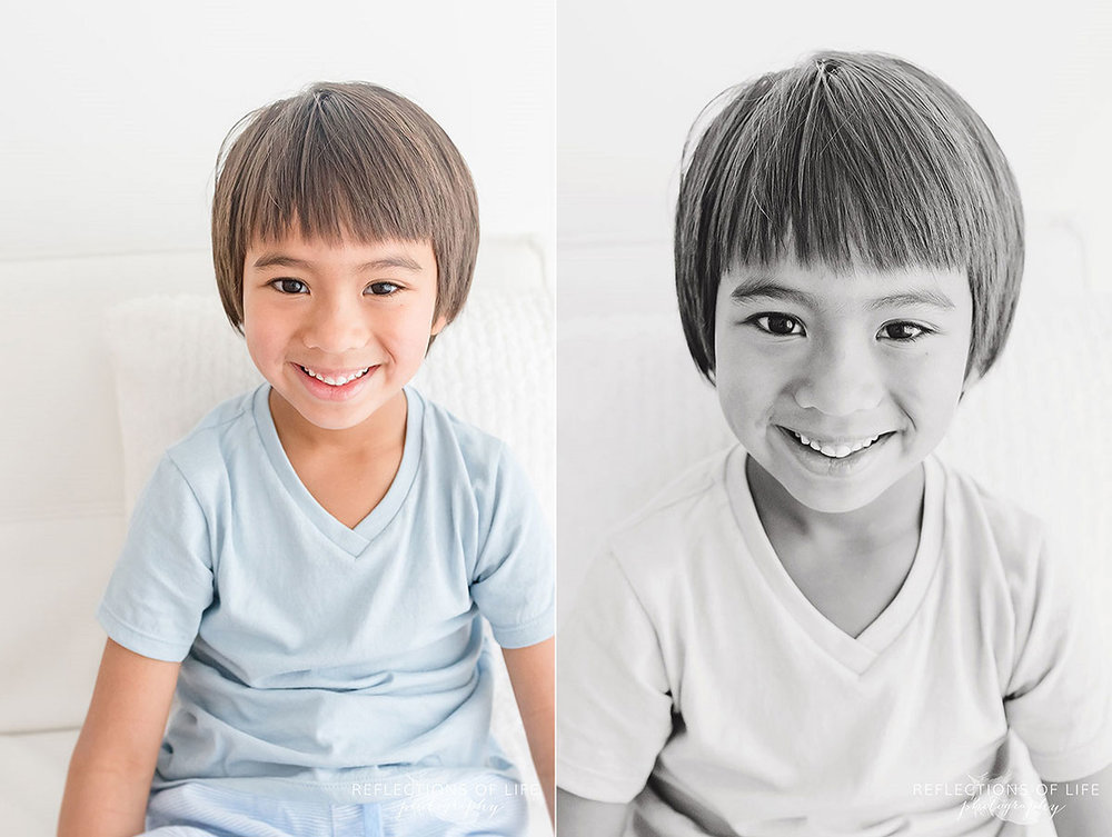 boy sitting and smiling colour black and white