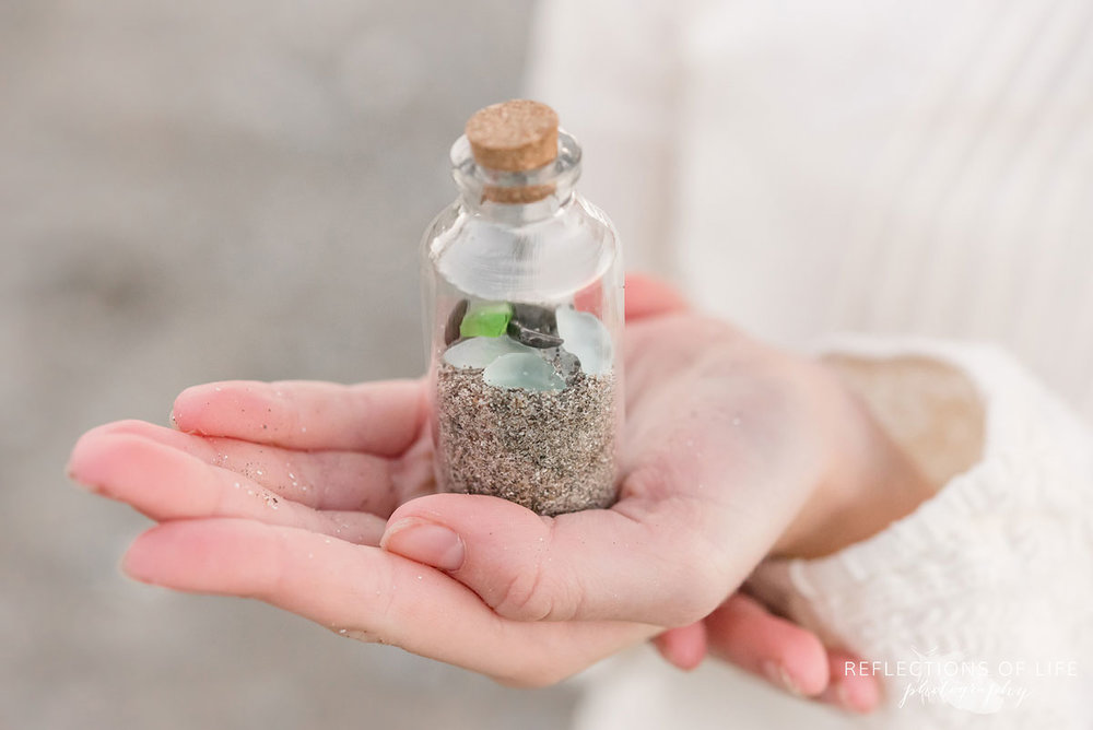 jar with beach sand and glass