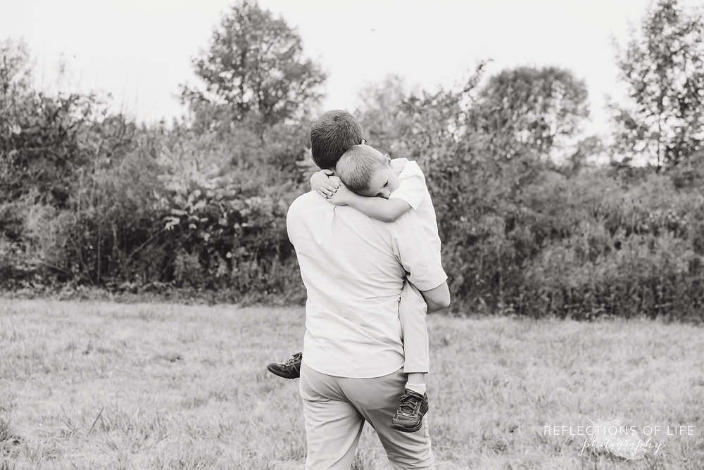 003 black and white of father holding son