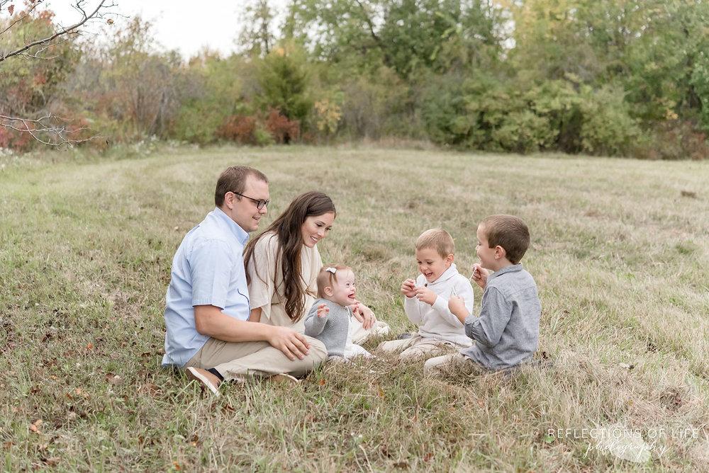 011 family lying in field