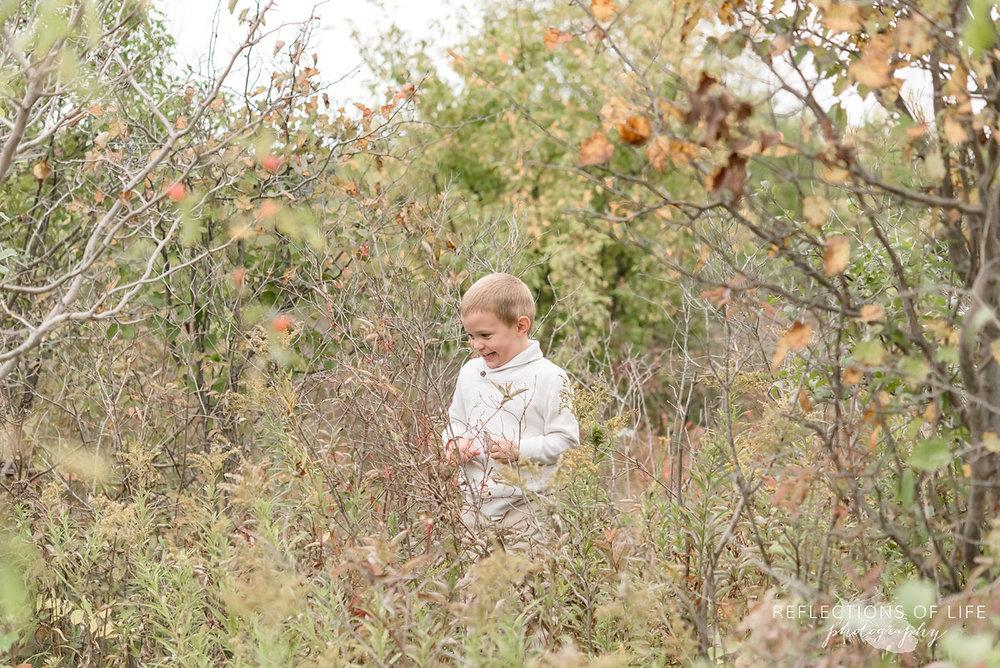 022 little boy exploring nature