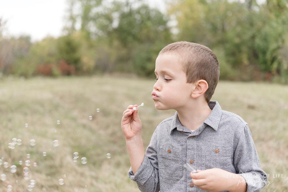 024 boy blowing bubbles in Niagara Region