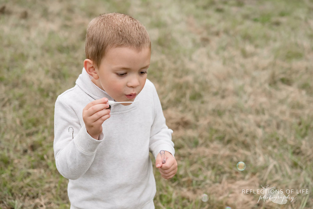 025 little boy blowing bubbles in Grimsby Ontario