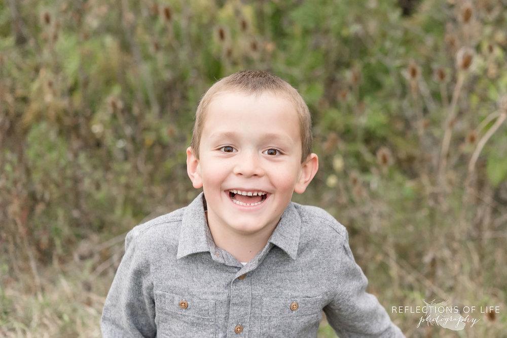 026 Young boy smiling at photographer Karen Byker