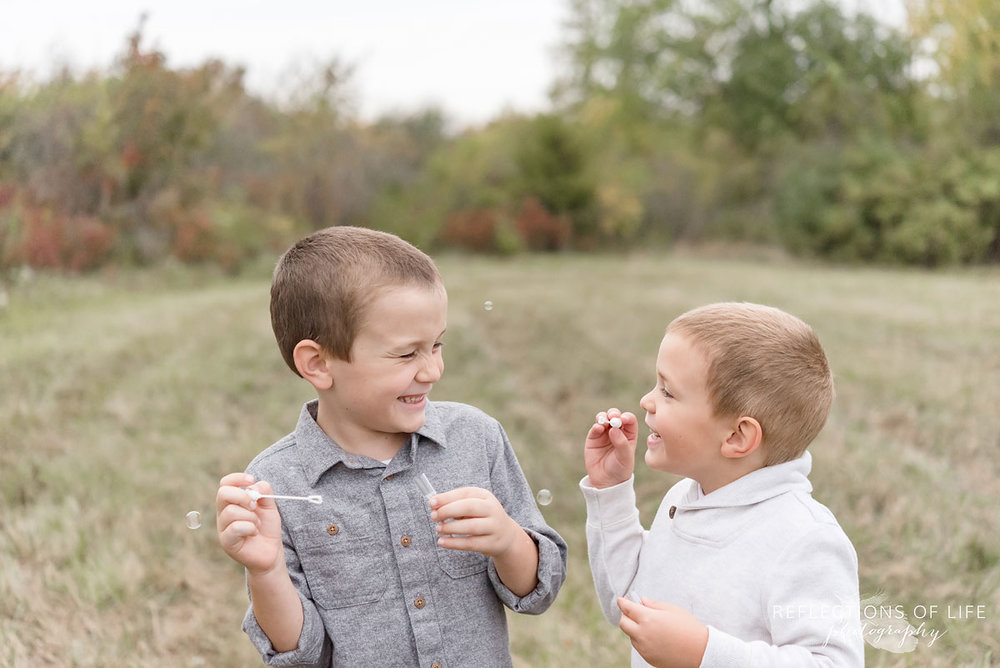 027 two brothers blowing bubbles in Grimsby Ontario
