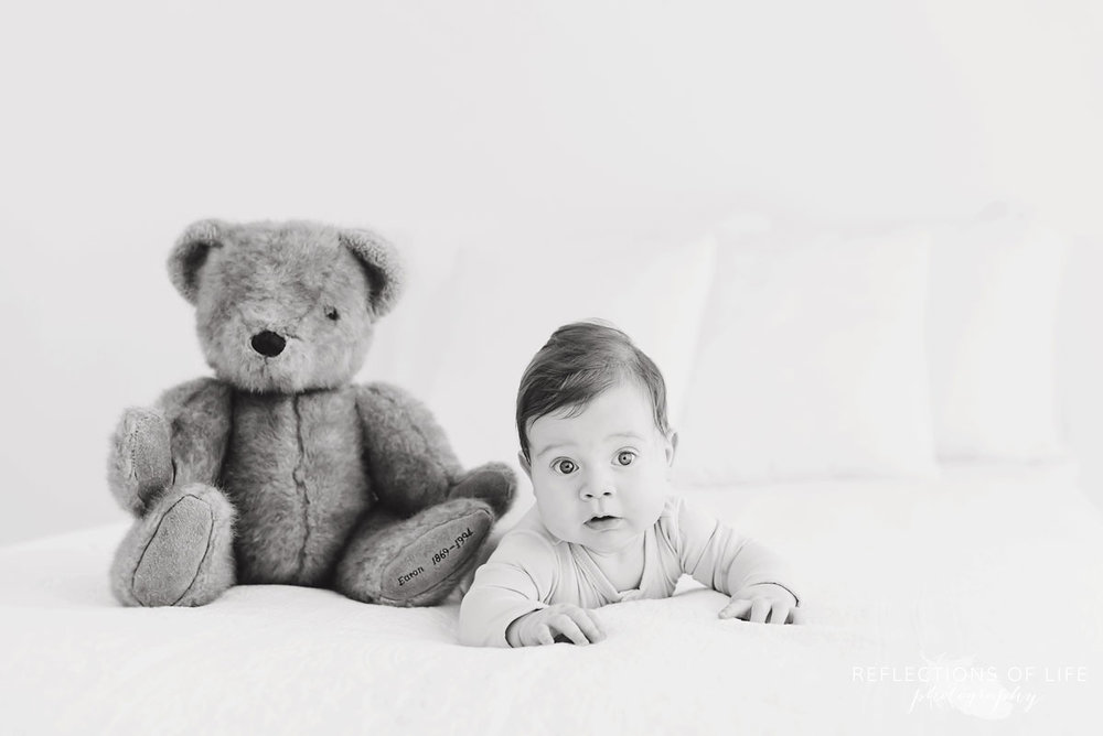 baby and teddy bear in studio