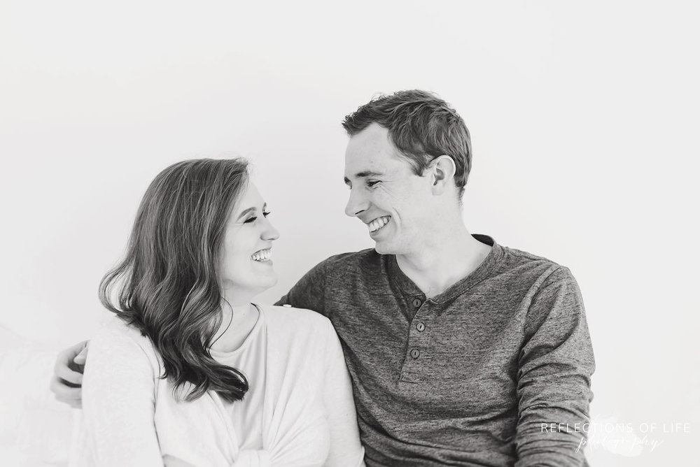 husband and wife laughing