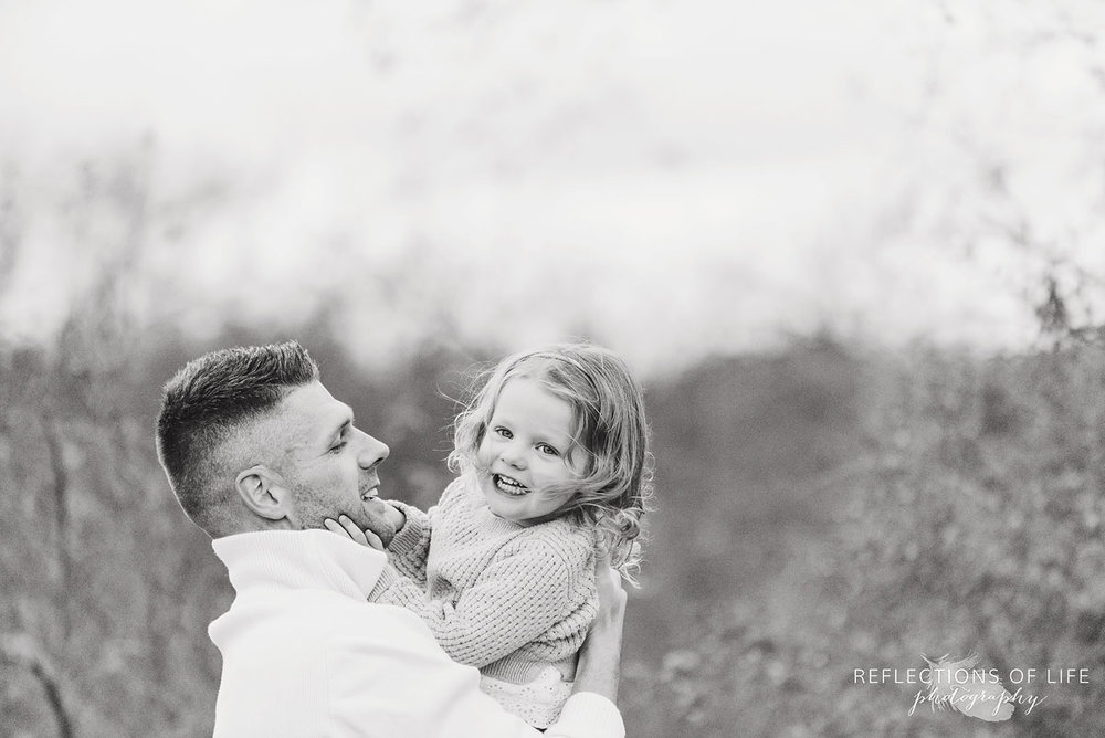 father and daughter black and white portraitfather and daughter black and white portrait