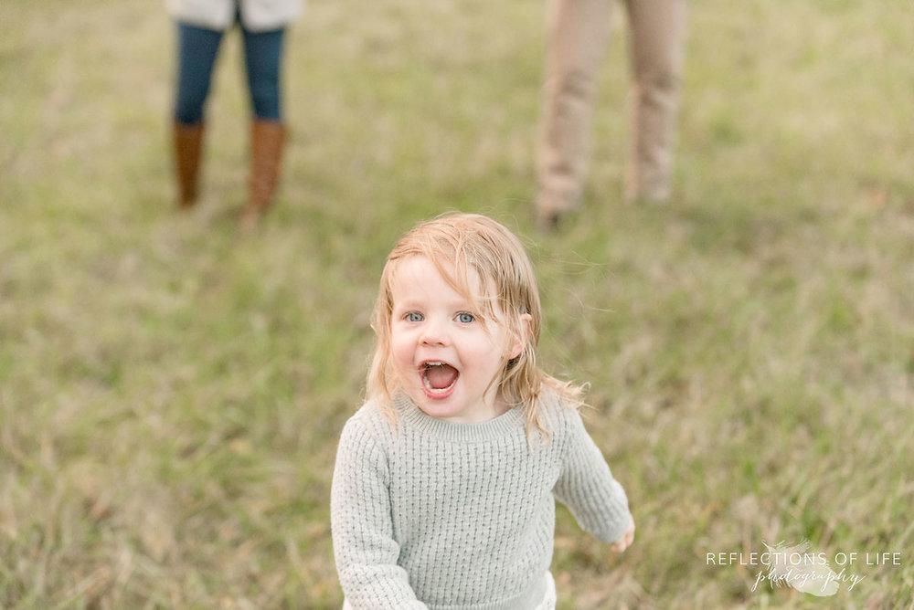 little girl running towards photographer karen byker