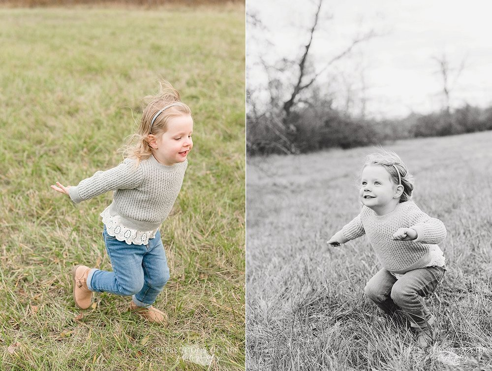 little girl running around in a field
