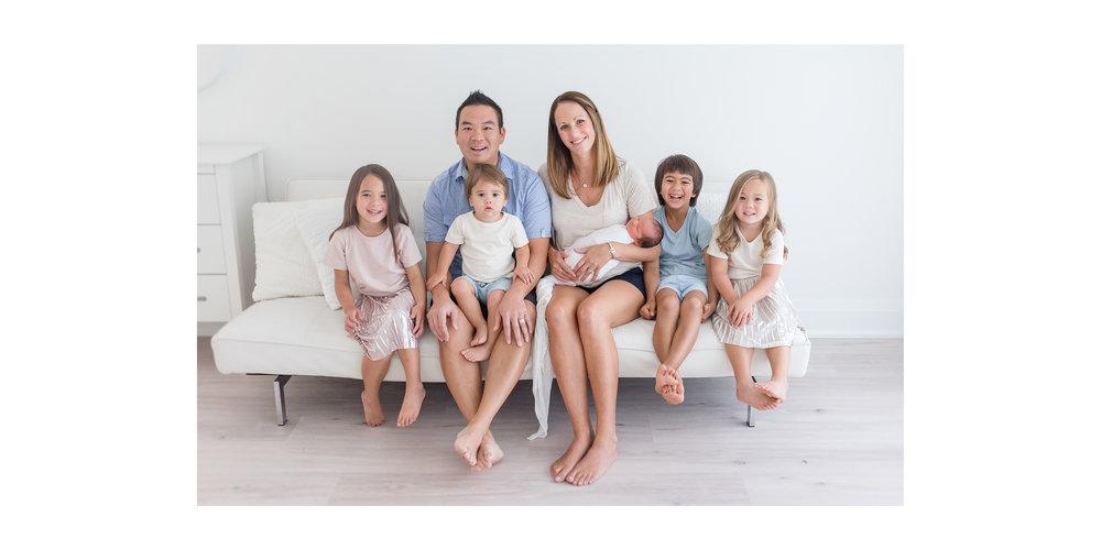 Big family in white studio