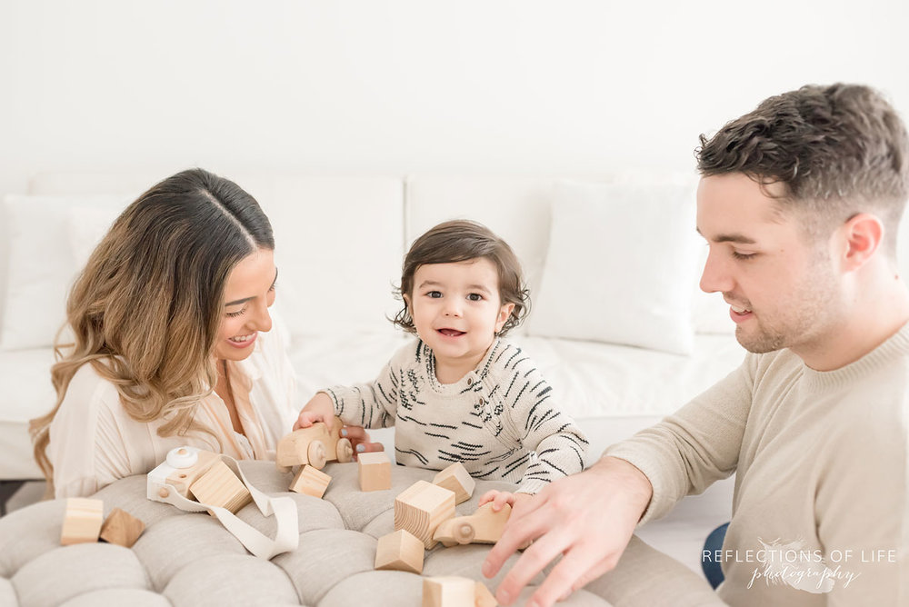 Family playing with blocks in studio