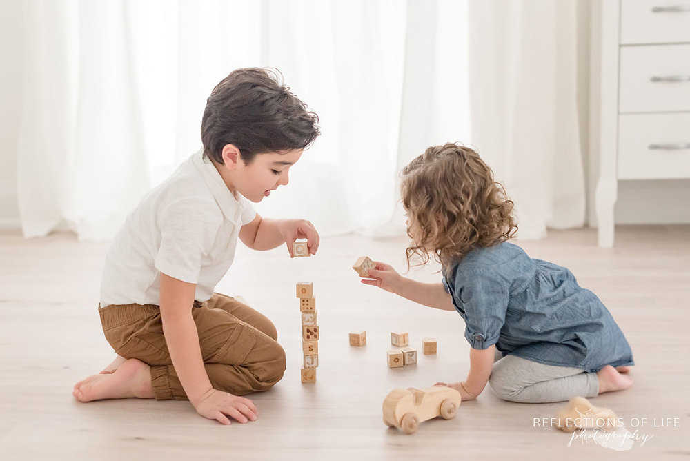 Siblings playing with blocks