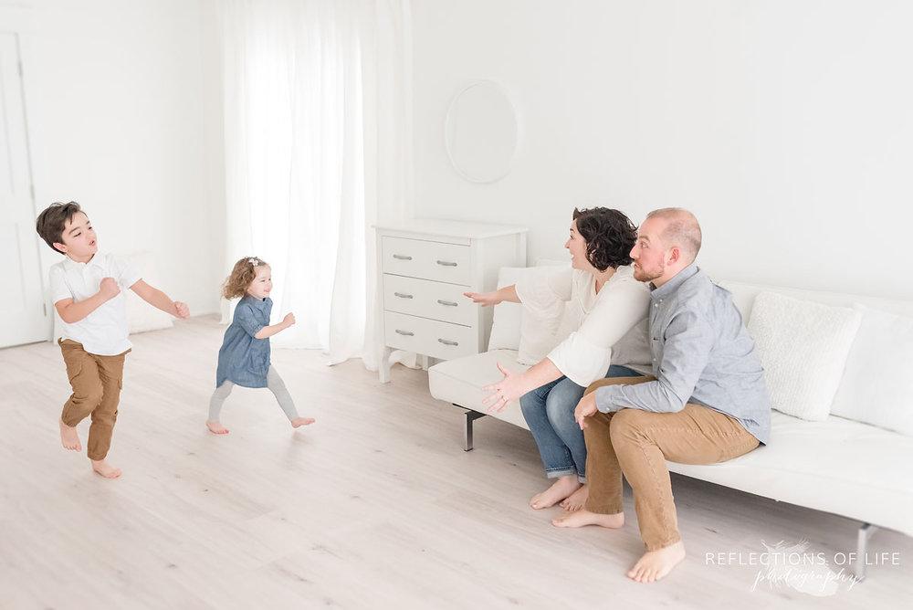 little children running to parents in studio