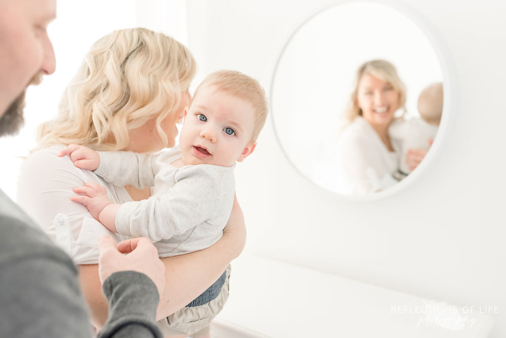 Copy of Copy of little boy having fun playing by a mirror in Niagara Ontario