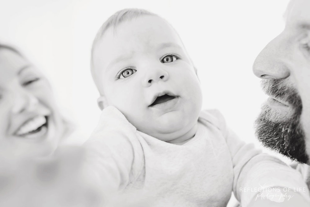 Copy of Copy of  baby boy trying to grab the camera in black and white