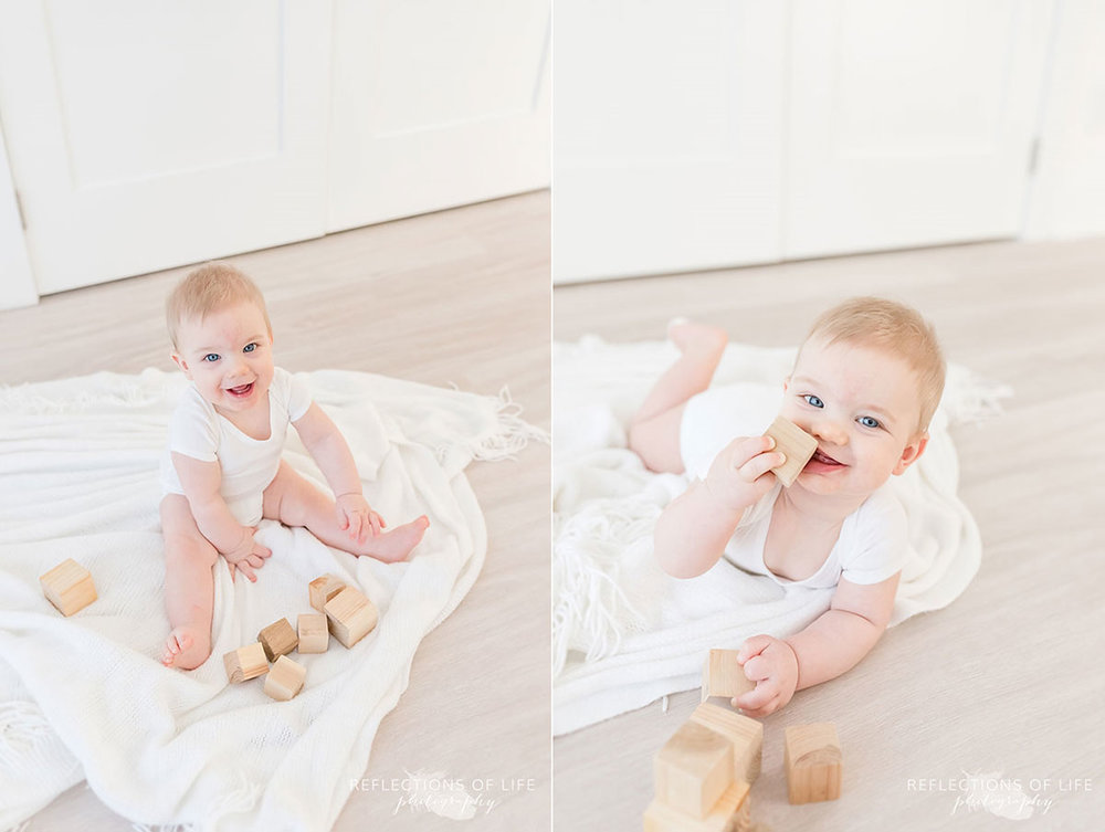 Copy of Copy of Little baby boy playing with wood blocks in natural light studio