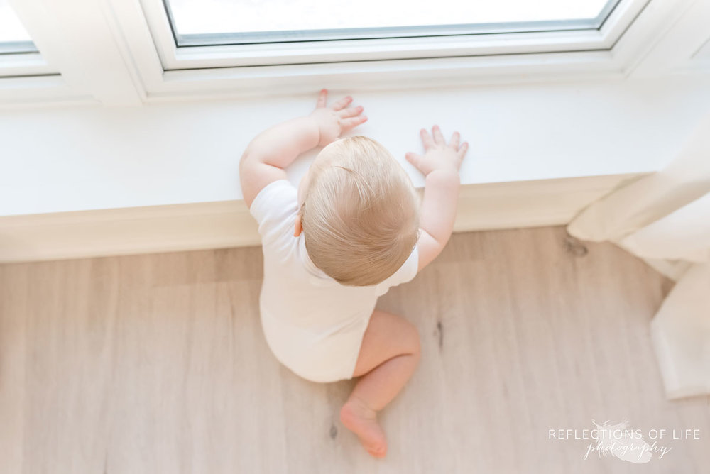 Copy of Copy of Baby boy looking out the window birds eye view