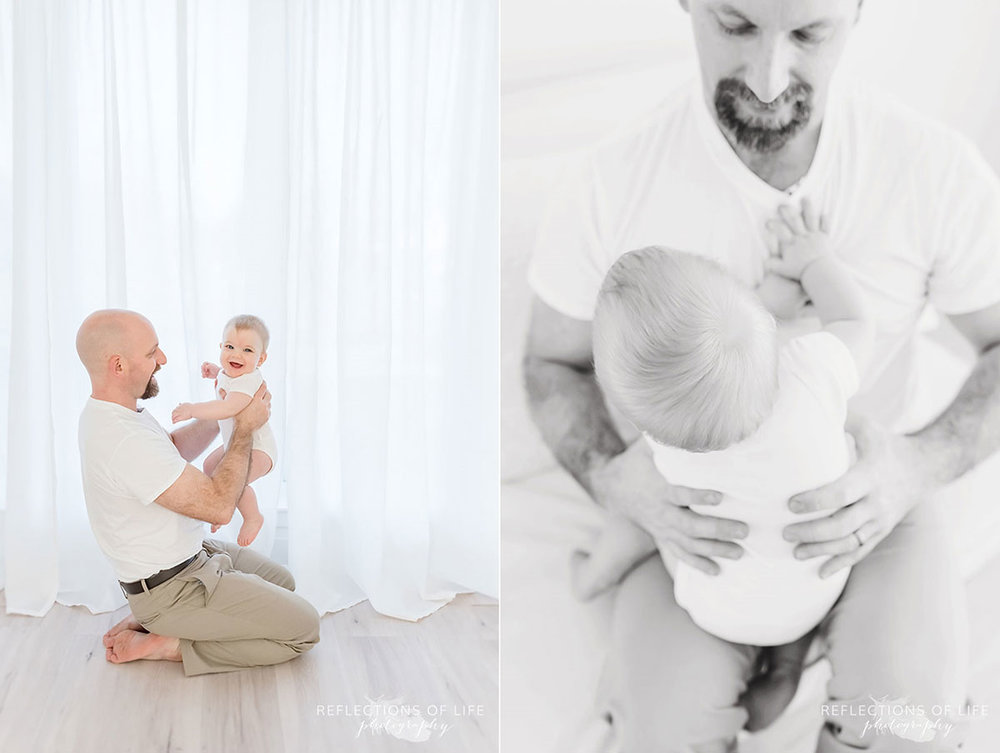 Copy of Copy of Baby boy in the arms of his daddy neutral colours
