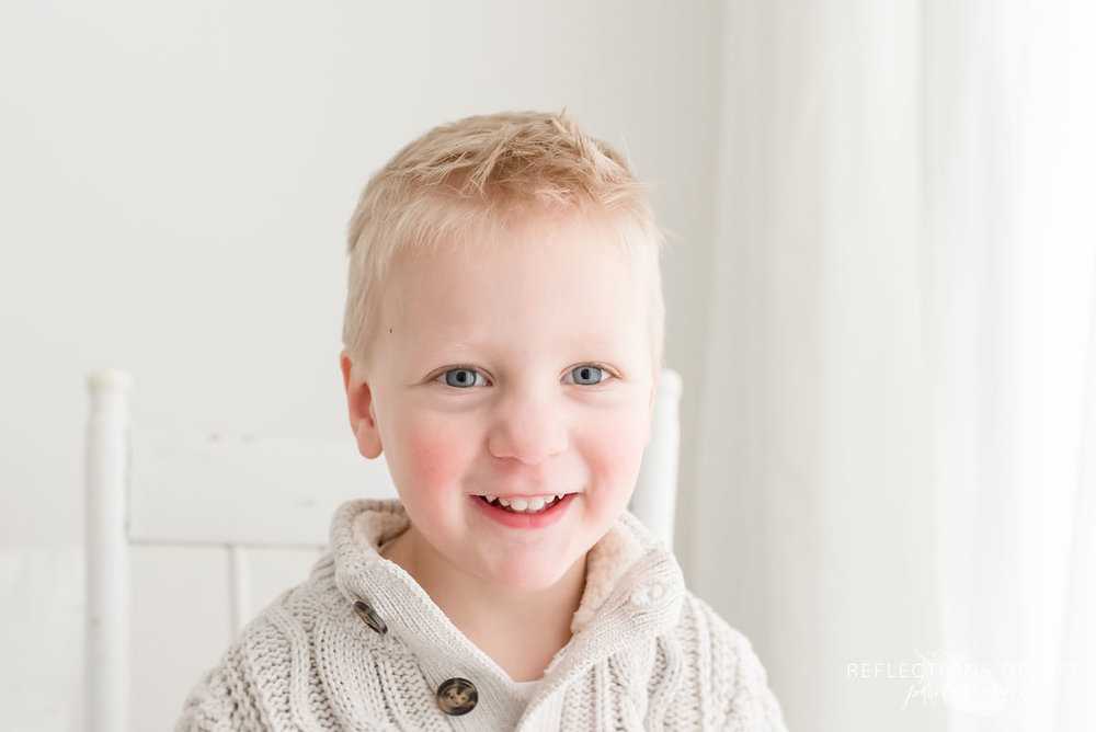 Portrait of little boy smiling at the camera.jpg