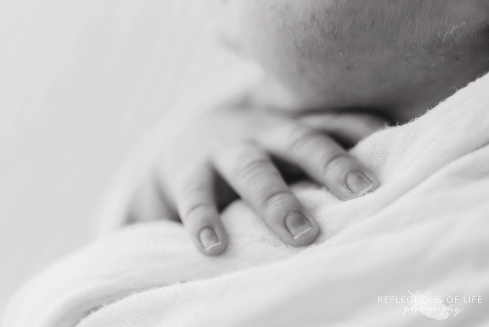 Newborn baby fingers with close up lens.jpg