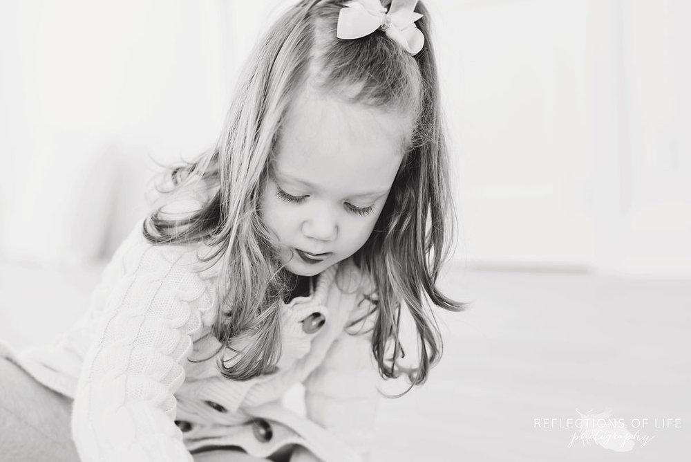 Cute little girl black and white in Niagara