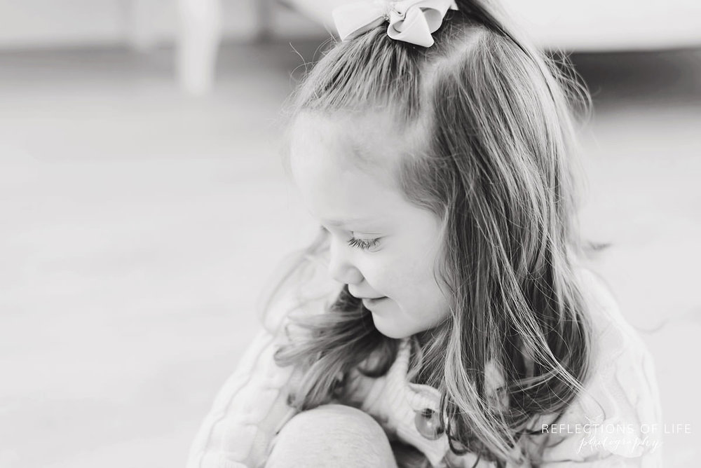 Cute little girl looking away black and white