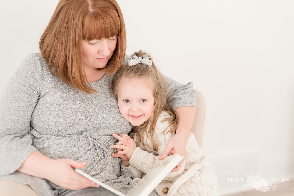 Mother and daughter read a book together in Niagara