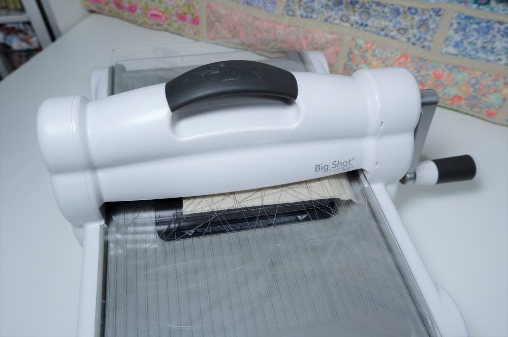 Roll your Sizzix sandwich through the machine.